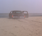 The mobster limo gets stuck in the sand.